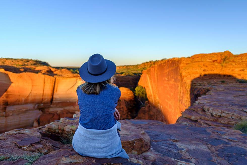 woman enjoying view overlooking canyon