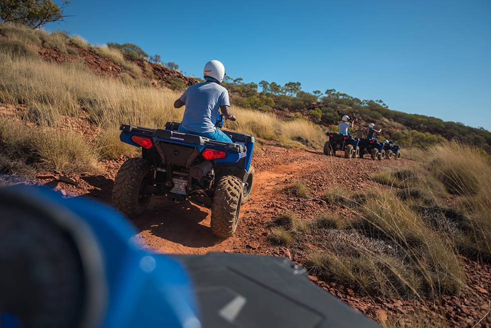 quad bikes riding down path